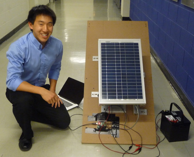 Photo of Joel and prototype of inclined rooftop solar tracker